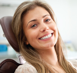 woman smiling in dentist's chair