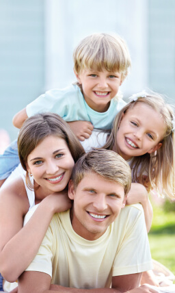 family smiling with pretty white teeth