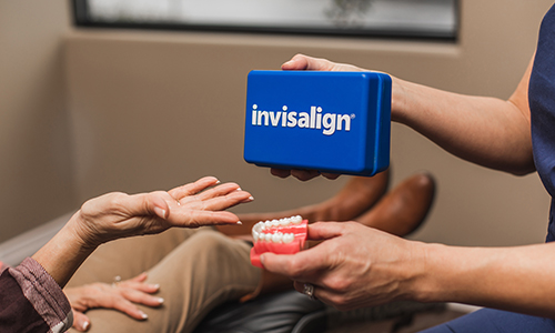 Hygienist handing over an invisalign box